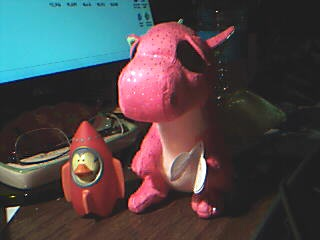 Darla the dragon and Percy the rocket duck. My current muses.